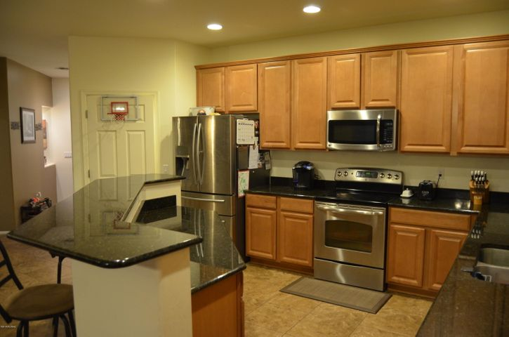 Gourmet Kitchen with Beautiful Granite and All Stainless Appliances.