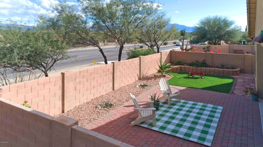 Fully landscaped includes pavers, garden beds, and astro turf.