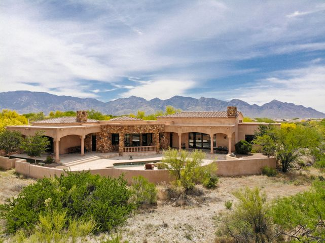 This Stone Canyon custom home is priced exceptionally well & under a recent appraisal.