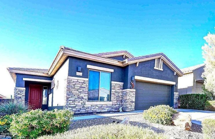 Front of Home w/desert plantings and side entry