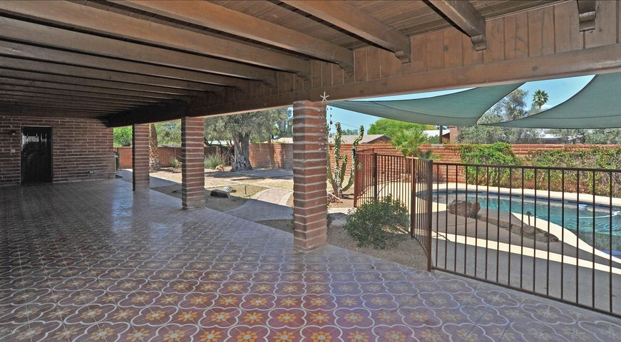 Deep covered back porch with mountain views and original encaustic tile,