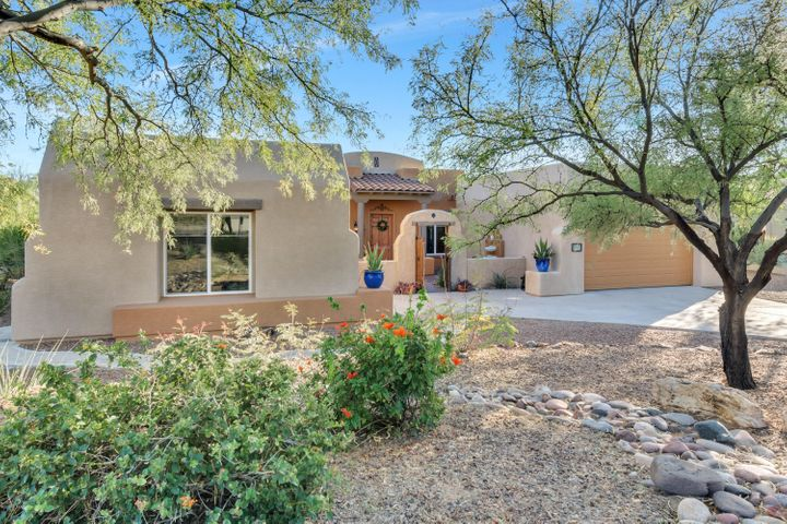 Enchanting curb appeal with lush landscape and wonderful level driveway leading to Courtyard Entry. Antique doors open up to ample courtyard where a lovely fountain greets you and welcomes you home