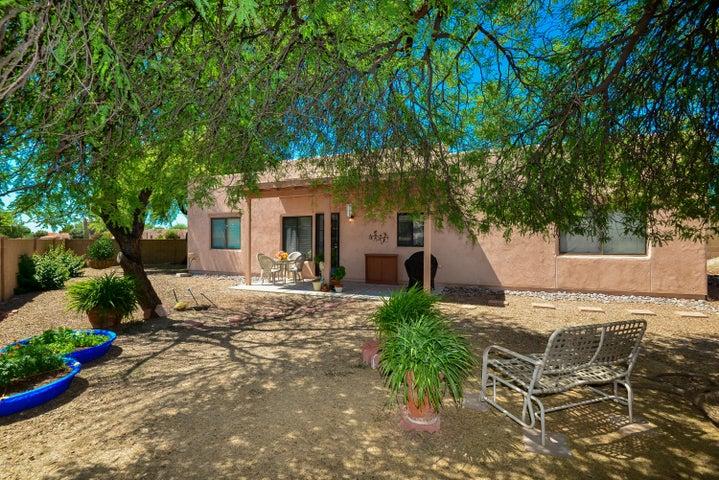 Big backyard with mature mesquite trees.