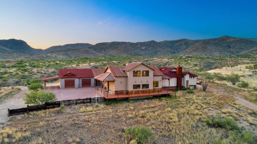 Taken from the West facing East, this home sits on top of its own ridge with panoramic views.