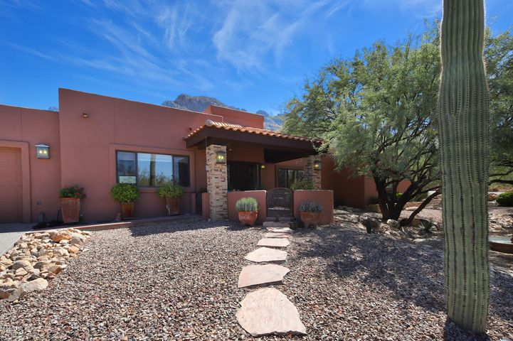 Welcome to 1061 E. Canada Vista Place nestled right up next to Pusch Ridge