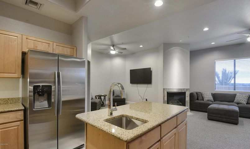 Remodeled Kitchen with granite countertops and stainless appliances including wine cooler