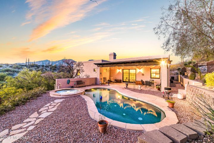 Meticulously maintained foothills residence has a beautiful backyard with resort-style amenities