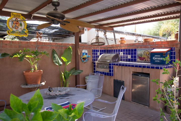 Fantastic pool side BBQ patio. Covering is corrugated metal - wired ceiling fan to help keep cool!