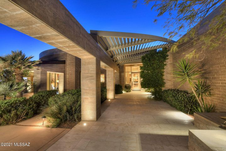 Travertine wrapped panels inspired by the Getty Museum, copper standing seam roof, integrated split faced block construction