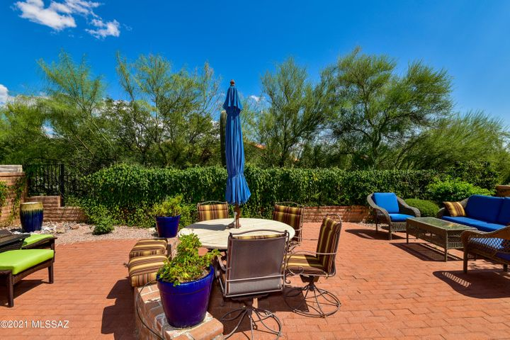 LARGE BRICK PATIO, ADJACENT TO COMMON AREA AND OFFERING MOUNTAIN VIEWS.