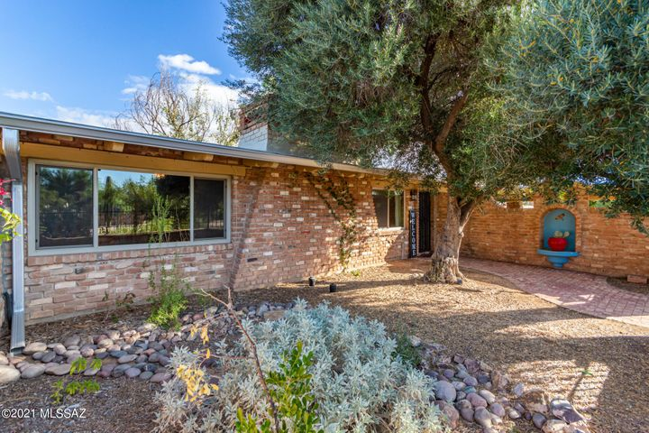 Enter the brick archway to a lovely courtyard that leads you to the main home at 1301 E. Lind Rd.