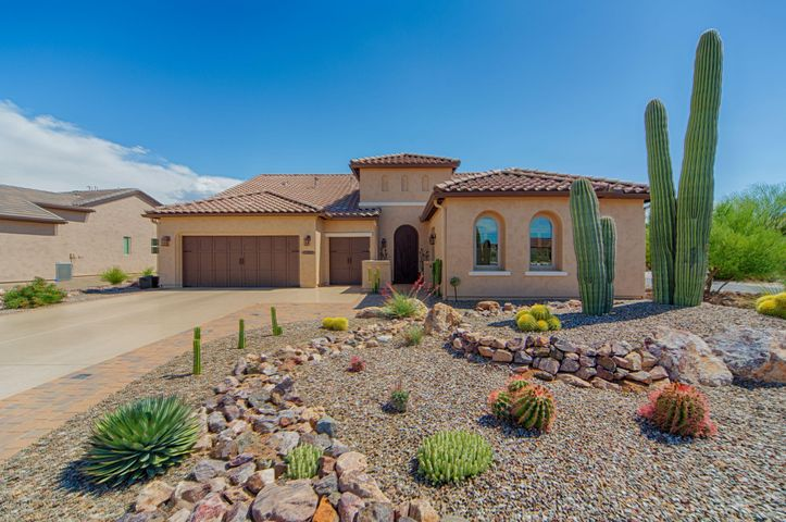 Come and take a look at this warm elegantly appointed 2-bedroom w/attached bathrooms, den, and guest bathroom in 2,619 sq. ft. This Pima model also has an attached casitas w/bathroom. This 10,018 sq. ft. oversized corner lot has one of the best views that SaddleBrooke offers. Freshly painted both inside and out, this home has over $140,000 in upgrades.  Structural changes include extended garage that has been seal-coated and with a golf cart bay, attached casitas, bump-out bay windows in master, and outdoor living space that has been permanently screened which has a above-ground spa that can be purchased separately.  22 solar panels (most monthly electric bills are $25 for fees) on the roof and fully paid for. The interior of the home has 20''x20'' oversized slate tiles throughout plantation shutters, high-end fixtures and window coverings, oversized fans, recessed lighting, solid alder doors throughout, granite countertops, 5 burner gas stove, oversized alder cabinets in kitchen with Xenon under cabinet lighting, imported Italian glass lights above island, and an incredible 14-foot high ceiling in the great room. The exterior of the home has stucco wall enclosing back yard, screened in patio, tranquil recirculating pond, 3 zone front and back irrigation, pavers front and back, and an outdoor gas grill hookup. Other features of the home include a security system, surround sound, central vacuum, reverse osmosis water softener, and hot water recirculating pump.   SaddleBrooke Ranch is a guard gated, active, world class resort-style community, clean air, 320 days of sunshine, 18-hole golf course (more to come), driving range, state-of-the-art workout facilities, indoor /outdoor pool, tennis/pickleball/bocce ball courts, biking and hiking trails, billiards and more. A friendly community with numerous clubs. Magnificent 50,000 sq. ft. clubhouse with upscale restaurant and amenities including a ballroom/auditorium with stage for entertainment, U-shaped bar, private dining