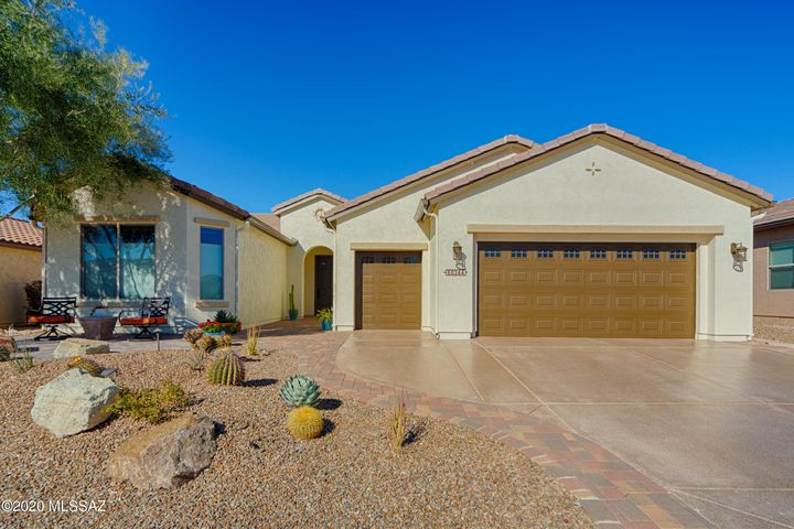 This popular Cortez model (2 BD/3 BA plus Den (2222 sq ft) built on a premium lot is positioned for optimal summer and winter sun and shade. Beautiful views of natural desert and  the 18th fairway enhance your enjoyment on the extended rear patio.  The home design boasts extensions to each bedroom with bay windows and a 4 ft. extension to the garage with New Age cabinetry. The private backyard patio comes with an almost new therapeutic spa and a Sunset Patio Perch.  Amenties included granite kitchen counters, SS appliances, gas cooktop, custom backsplash.  Master Bdrm includes walk-in closet.  Saddlebrdooke Ranch amenties feature fitness center, manned gate, restaurant salon and spa indoor and outdoor pools, golf, pickleball, tennis, clubhouse, dog park.