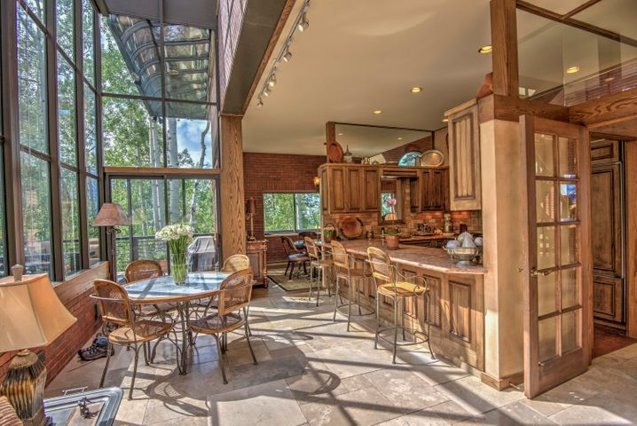 This home is beautifully landscaped with a large open deck and light filled sun room as part of the house.