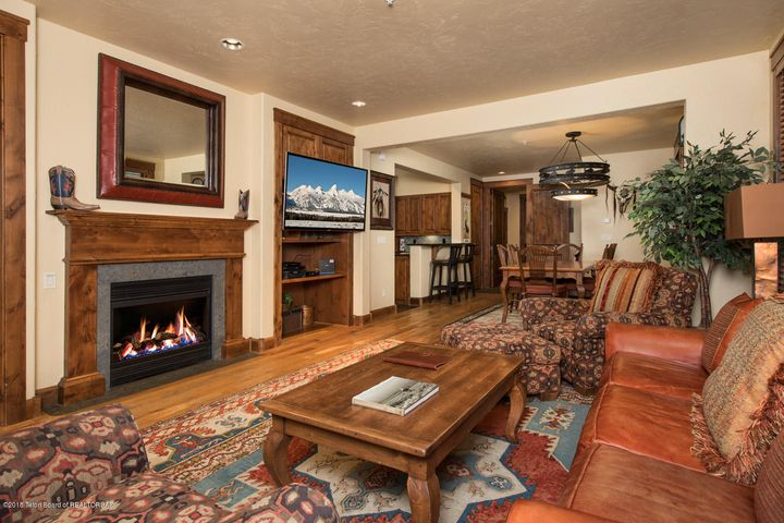 Spacious Living Room with a Gas Fire Place