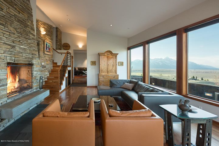 Great room with wood-burning fireplace.