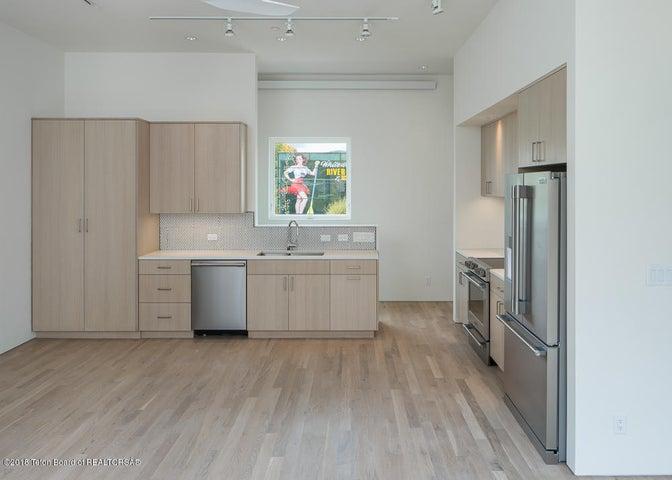 Looking at kitchen (sample)