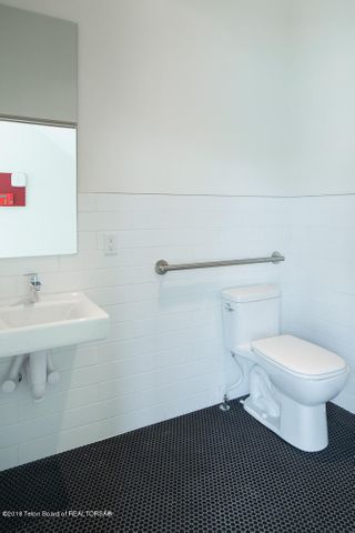 Lower level office space bath