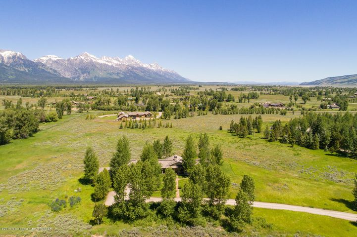 Aerial of property and Tetons