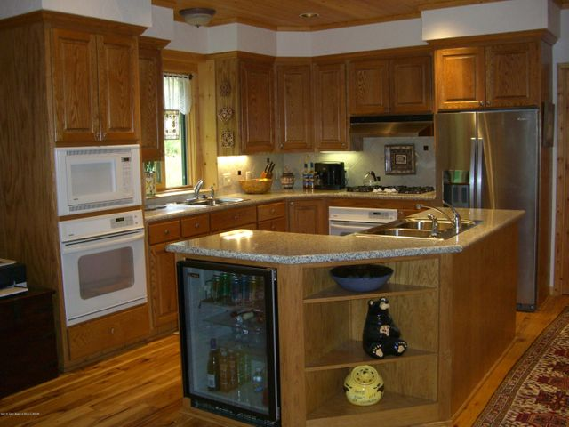 Kitchen with Granite Slab Counter Top