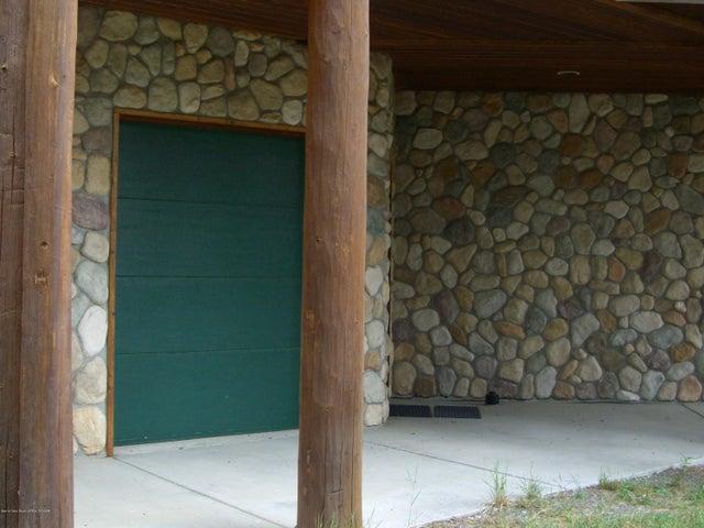 Snowmobile and Storage Garage Door