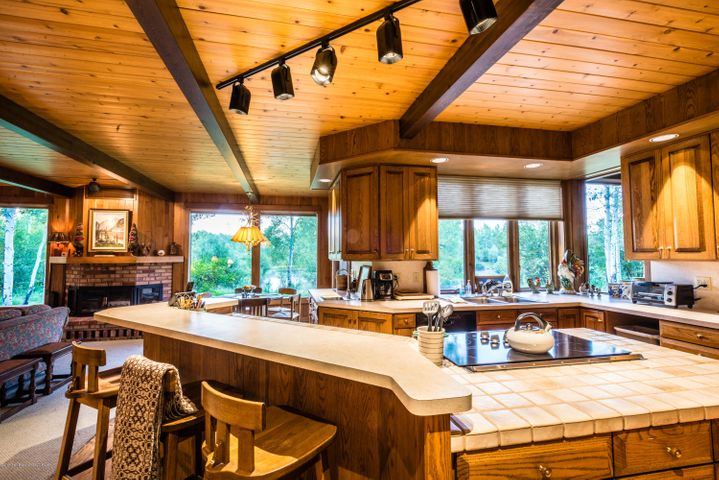 Entertain guests from kitchen