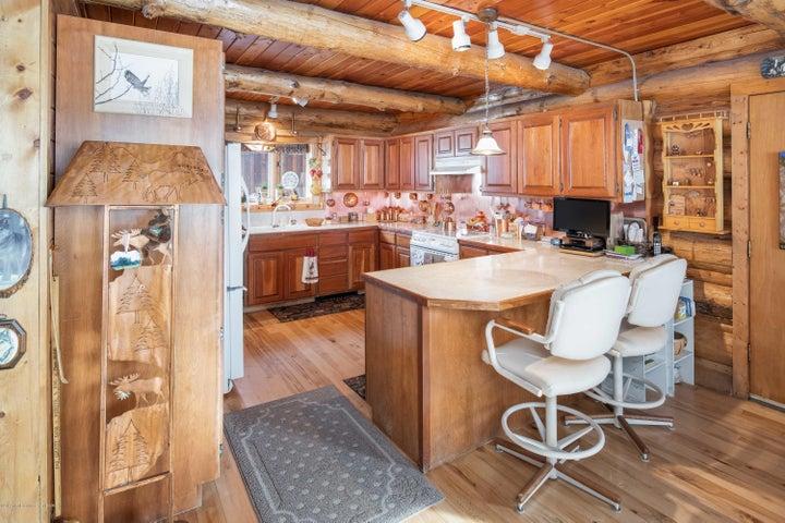 Kitchen with copper backsplash