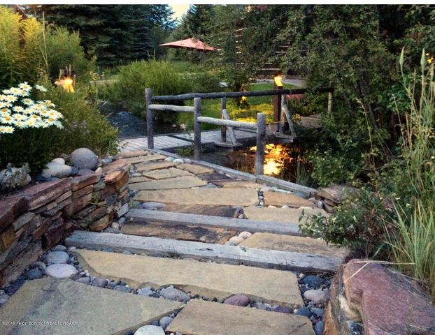 Charming bridge and pathway to entry