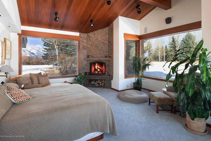 Master bedroom fireplace and Tetons