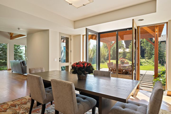 Dining room flowing to outside
