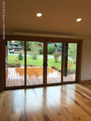 Double sliding door to deck