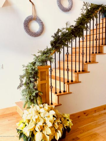 Staircase to 3 en suite guest rooms