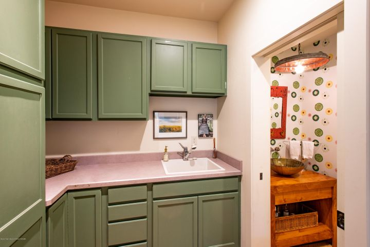 utility room and guest bathroom
