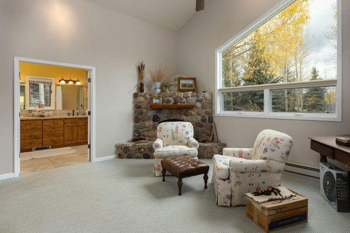 Primary bedroom with gas fireplace