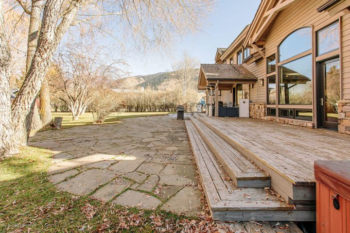 Covered Porch, Stone Patio and Deck