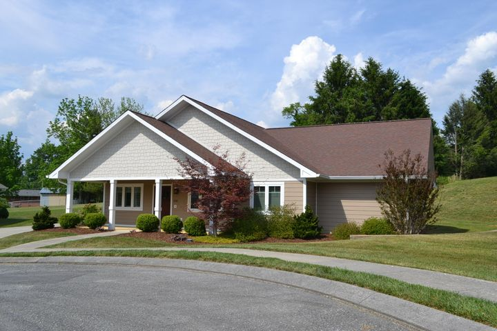 Front View with large covered porch and professional landscaping