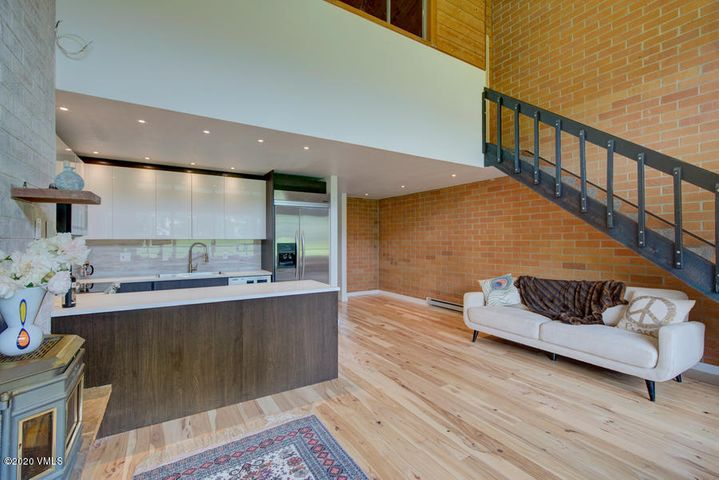 New modern kitchen with real wood floors from Colorado trees