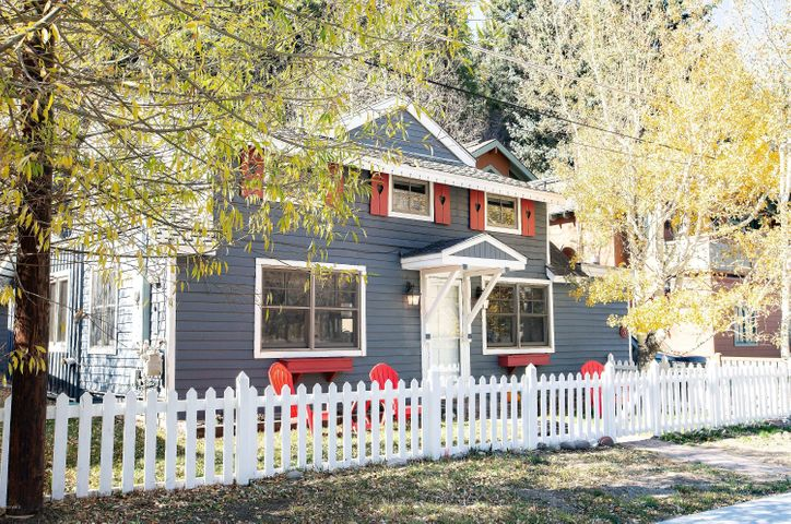 Showcasing the exterior front and the fenced in front of this inviting home and side yard. Park directly in front of your home for easy access.