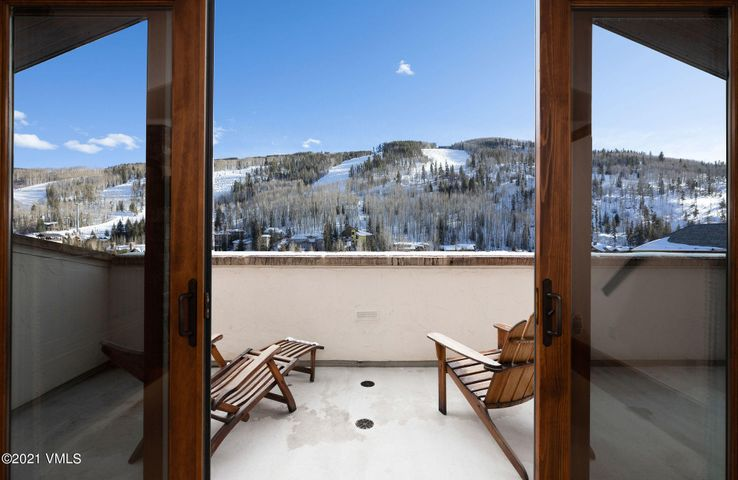 Views of the slopes from the great room or your private and quite 440+/- square foot heated deck.