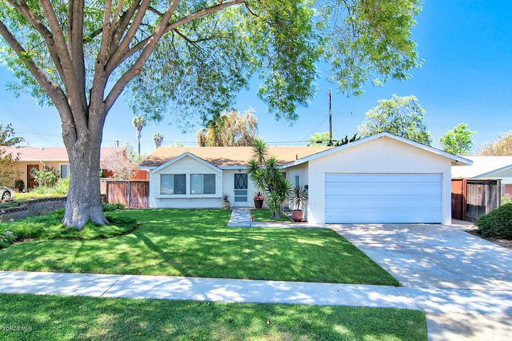 Great curb appeal with lovely mature trees and appealing landscaping.