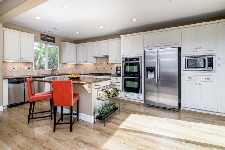 Sleek granite and beautiful off white cabinets