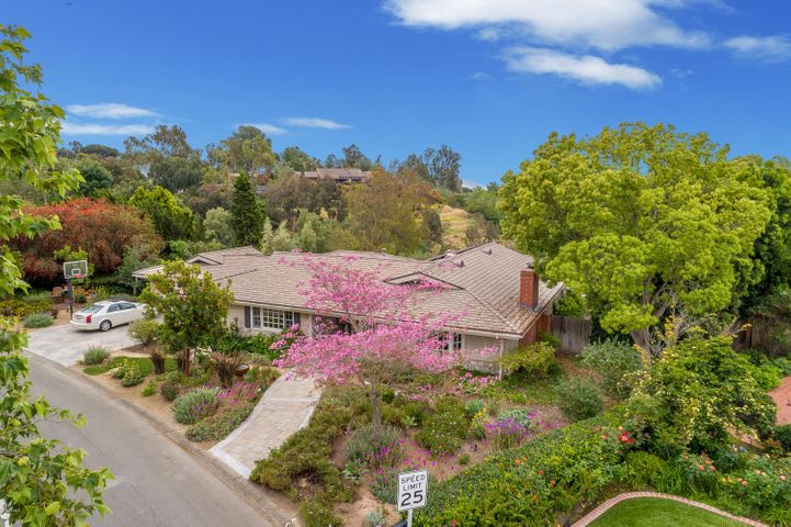 Nestled on private spacious lot 1/2 acre