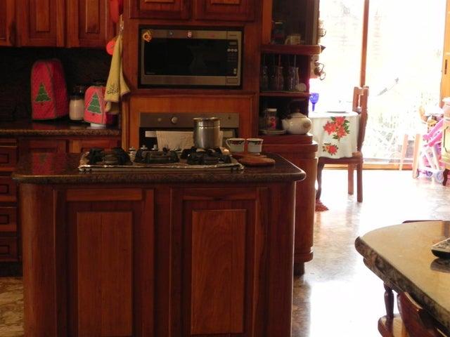 Casa Distrito Metropolitano>Caracas>Prados del Este - Venta:300.000 Precio Referencial - codigo: 19-4484