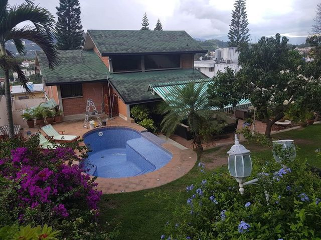 Casa Distrito Metropolitano>Caracas>Cumbres de Curumo - Venta:800.000 Precio Referencial - codigo: 19-7952
