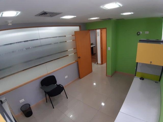 Oficina Distrito Metropolitano>Caracas>La Castellana - Venta:1.100.000 Precio Referencial - codigo: 19-13052