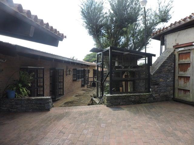 Casa Distrito Metropolitano>Caracas>La Lagunita Country Club - Venta:695.000 Precio Referencial - codigo: 20-9969