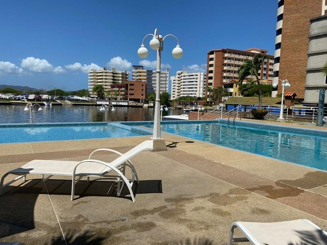Apartamento Miranda>Higuerote>Puerto Encantado - Venta:75.000 Precio Referencial - codigo: 20-10357
