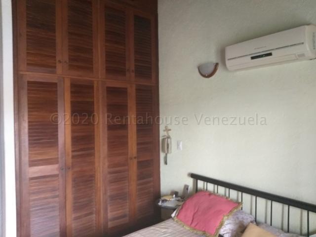 Casa Distrito Metropolitano>Caracas>La Lagunita Country Club - Venta:389.700 Precio Referencial - codigo: 21-6548