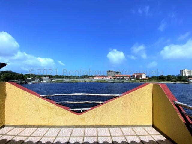 Townhouse Miranda>Higuerote>Puerto Encantado - Venta:165.000 Precio Referencial - codigo: 21-19429