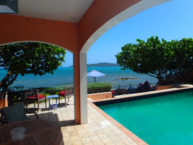 Out side patio, pool, and ocean view with Buck Island in the background.